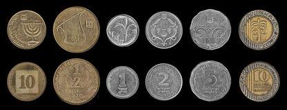 Münzen auf dem Schwarzen Stockbilder