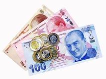 Münzen auf Geldbündel Stockfoto