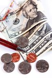 Münzen auf US-Bargeld Lizenzfreie Stockbilder