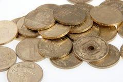 Münzen auf Weiß Stockbilder