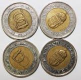 Münzen auf Weiß Stockfotografie