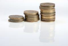 Münzen auf Weiß Lizenzfreies Stockfoto