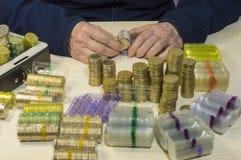 Münzen in der Blister Packung Lizenzfreie Stockfotos