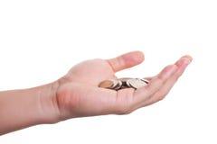Münzen in der Hand Lizenzfreie Stockbilder