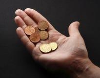 Münzen in der Hand Lizenzfreie Stockfotografie