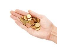 Münzen in der Hand Stockbilder