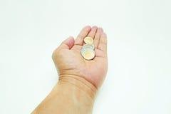 Münzen in der Hand Lizenzfreie Stockfotos