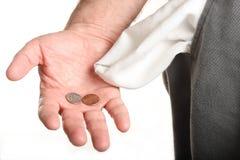 Münzen in der Hand mit Tasche Lizenzfreie Stockfotos