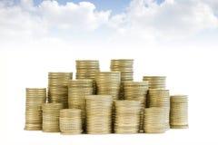 Münzen getrennt auf weißem Hintergrund Lizenzfreie Stockfotos