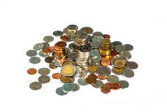 Münzen getrennt auf weißem Hintergrund lizenzfreie stockfotografie