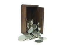 Münzen im Kasten Stockfotos