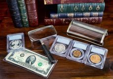 Münzen-Sammelnhobby lizenzfreie stockbilder