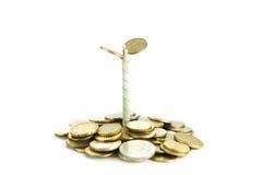 Münzen und Anlage, getrennt auf weißem Hintergrund Lizenzfreies Stockfoto