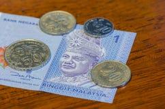 Münzen und Banknoten des malaysischen Ringgit Lizenzfreie Stockfotos
