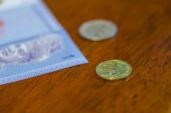 Münzen und Banknoten des malaysischen Ringgit Lizenzfreie Stockfotografie