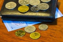 Münzen und Banknoten des malaysischen Ringgit Stockfotos