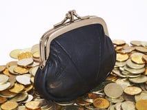 Münzen und ein Fonds stockbild
