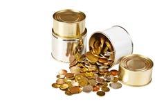 Münzen und können Stockfotos