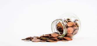 Münzen verschüttet Stockbilder