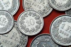 Münzen von der Schweiz Stockfotos