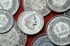 Münzen von der Schweiz Libertas-Kopf Stockbilder