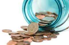 Münzen von einer Münzen-Querneigung lizenzfreies stockbild