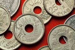 Münzen von Spanien Don Quijote und Windmühle Stockfotografie