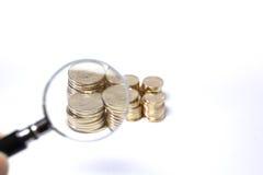 Münzenvergrößerungsglas Stockfotos