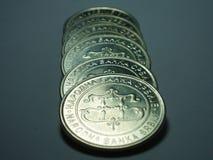 Münzenzeile Stockbild