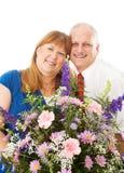 Żona Dostaje kwiaty od męża zdjęcie stock