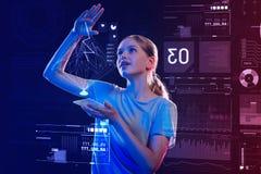 Mądry ucznia czuć uradowany podczas gdy tworzący realistycznego hologram Zdjęcia Stock