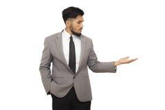 Mądrze biznesowy mężczyzna przedstawia twój produkt obraz royalty free