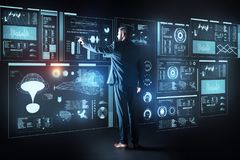 Mądrze programista dotyka ekran podczas gdy pracujący z futurystycznym komputerem zdjęcie stock