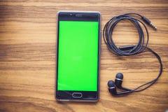 Mądrze słuchawki i telefon obrazy royalty free