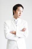 mężczyzna azjatykci kostium Bierze fotografię w studiu Obrazy Royalty Free