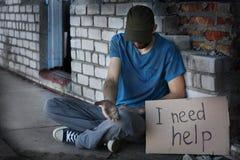 Mężczyzna błaga dla pomocy zdjęcie royalty free