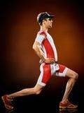 Mężczyzna biegacza triathlon działający ironman obraz stock