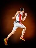 Mężczyzna biegacza triathlon działający ironman odizolowywający fotografia stock