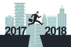 Mężczyzna biznesmen skacze 2017, 2018 na tła mieście od Obraz Royalty Free