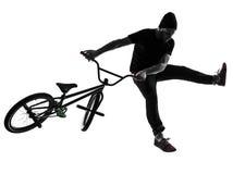 Mężczyzna bmx postaci akrobatyczna sylwetka fotografia stock