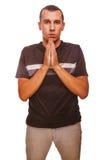 Mężczyzna brunetka modli się chrystianizm ręki wpólnie Obrazy Royalty Free