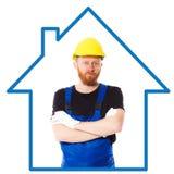 Mężczyzna budowniczy w błękitnym mundurze Obrazy Stock