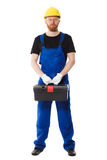 Mężczyzna budowniczy w mundurze trzyma narzędziowego pudełko Fotografia Stock