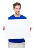 Mężczyzna chwyt z pustą deską zdjęcia royalty free