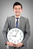 Mężczyzna chwyta zegar Zdjęcie Royalty Free