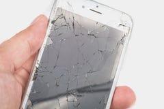 Mężczyzna chwyty w jego wręczają iphone 6S Apple Inc zdjęcie stock