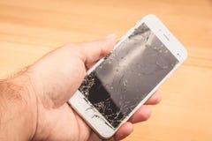 Mężczyzna chwyty w jego wręczają iphone 6S Apple Inc obraz royalty free