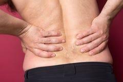 Mężczyzna cierpi od backache obraz royalty free
