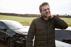 Mężczyzna cierpienie Z Whiplash urazem Po wypadku samochodowego Zdjęcie Royalty Free