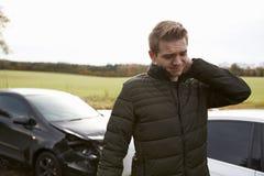 Mężczyzna cierpienie Z Whiplash urazem Po wypadku samochodowego Fotografia Royalty Free